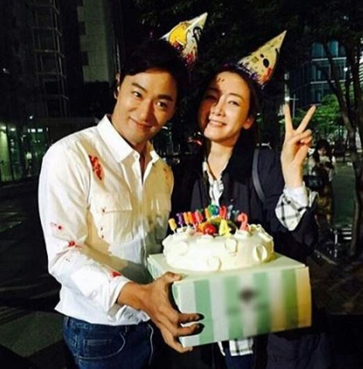 Choi Ji-woo and Joo Jin-moo with cake and cones