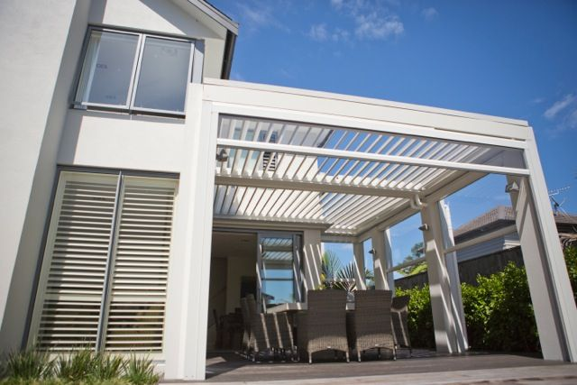 Louvretec Opening Roof with clear PVC blinds open. Maximising space in a small area - creating another room.  Your Outdoor Room.