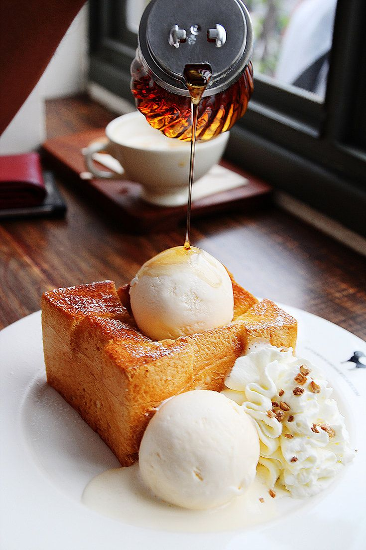 Classic Shibuya honey toast (buttered on every side.) Plated with two generous scoops of vanilla ice cream and a thick squirt of whipped cream.