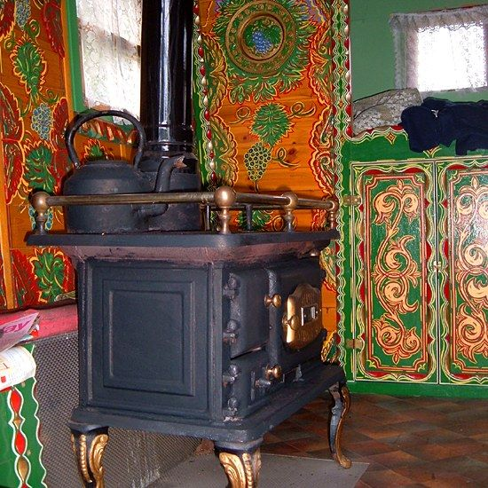 Inside the left-hand caravan. A wood-burning stove for cooking and heat in the winter. You'd have to be c...