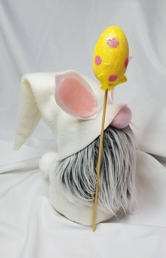 Baldur the Easter bunny gnome is hoping his way right into your heart! This little guy stands 9 inches tall and is made with all new materials including fleece, felt, faux fur, foam/wood egg staff, polyester fiberfill, rice for a weighted base and of course, Love! All gnomes are