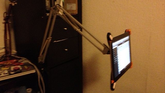 """""""Pair a $9 desk lamp with an iPad bracket and youve got a convenient way to read or watch on the iPad handsfree."""""""
