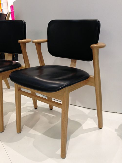 Upholstered Domus chair by Ilmari Tapiovaara. Produced by Artek.