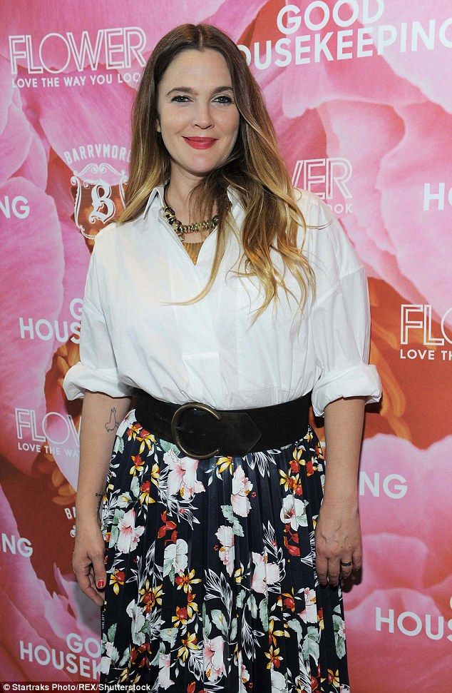 In bloom: The 41-year-old wore a pretty pleated skirt with a tropical flower pattern...