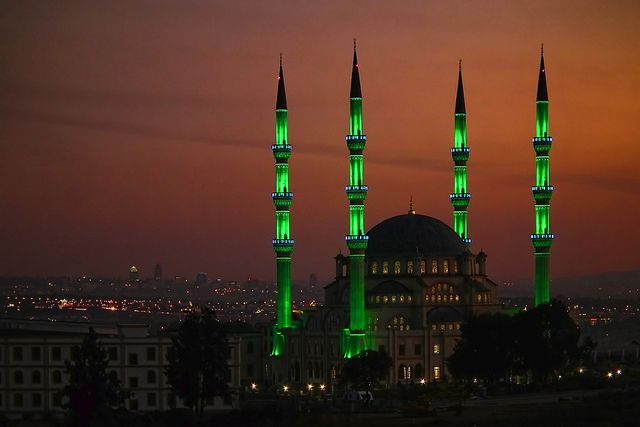 The minarets of Nizamiye Masjid glowing in the night, the largest mosque in southern hemisphere, Johannesburg, South Africa (by lencomb).