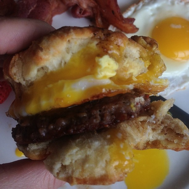Homemade buttermilk biscuits, eggs and spicy sausage patty.Homemade Buttermilk Biscuits