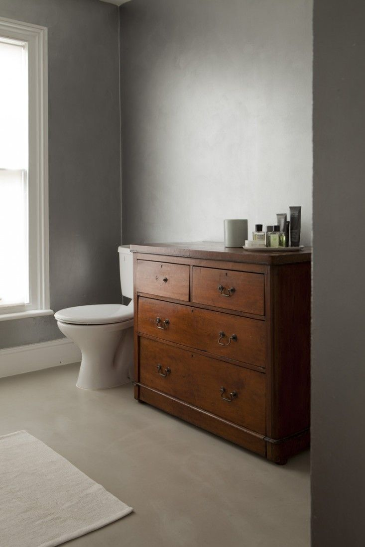 William Smalley flat in Bloomsbury, silver bathroom, Presbyterian Victorian chest of drawers| Remodelista