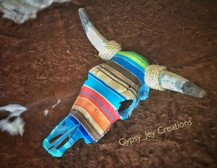 Hand painted Serape themed cow skull. Fits perfect with any southwestern or country home!