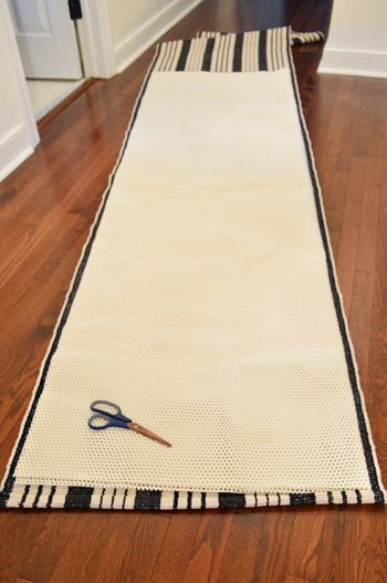 Young House Love | Stairs and Stripes (Installing A Stair Runner) - 5x8 rug pad from Target, cut in half.
