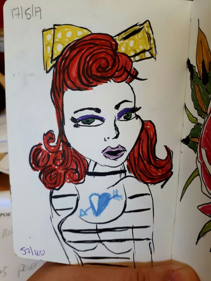 I can't stay away from the rockabilly ladies. I'm loving the tattoos and stripes and flowers in her hair