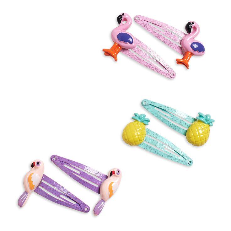 Glittrande och färgstarka hårspännen med frukter, flamingos och papegojor.