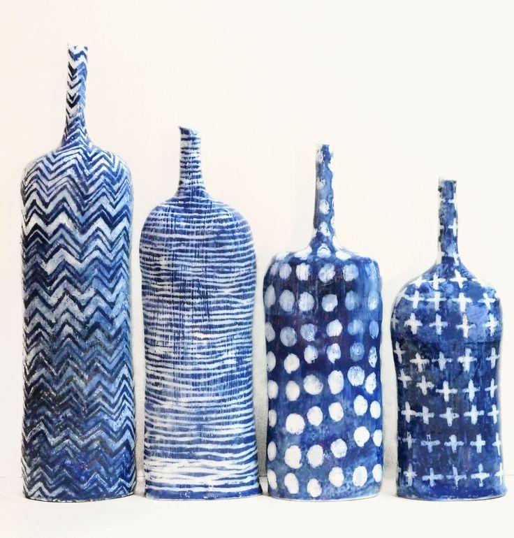 INDIGO TEXTILE BOTTLES by Brenda Holzke. Handbuilt stoneware bottles with colbalt carbonate decoration.