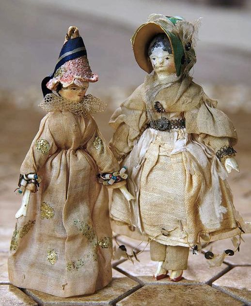 Two Early Grodnertal Wooden Dolls in Original Costumes.