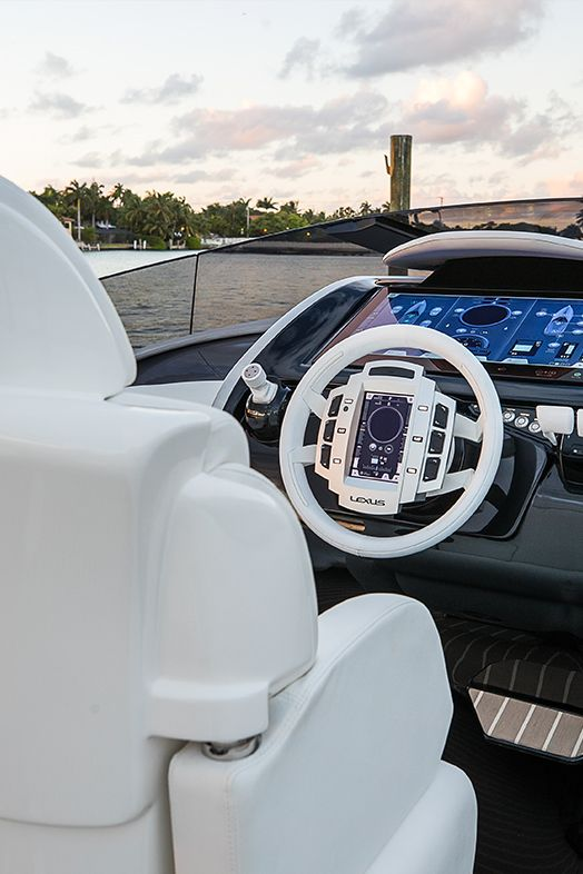 Kick back in the captain's seat of the Lexus Sport Yacht concept, and monitor onboard systems from a color touchscreen panel at the helm. The screen displays provide GPS navigation, digital charts, surface radar, underwater sonar, lighting and entertainment systems. From the exclusive reveal event at Di Lido Island on Biscayne Bay, Miami Beach, FL.