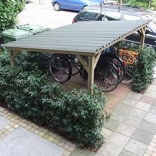 Afbeeldingsresultaat voor fietsenberging tuin