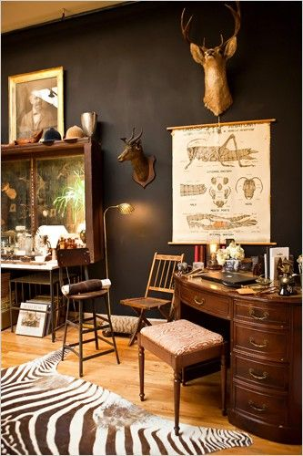 So great design elements for the EWnglish Study Media and Meeting Room. I love the black walls and simple wooden elements. Taxidermy a must. Zebra rug - love.
