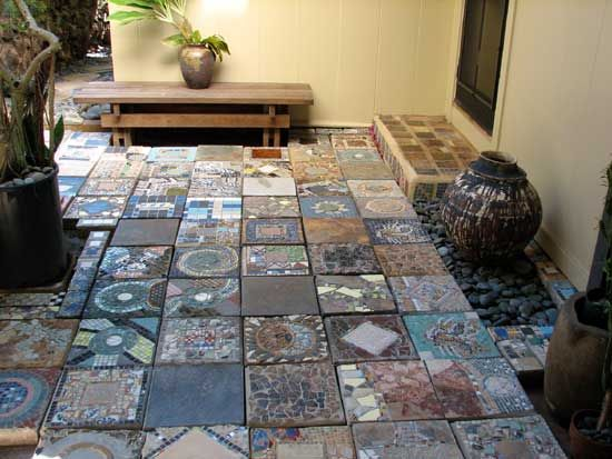 Note that the mosaic stepping stones above were made by using thinset bonding mortar to attach tiles to pre-made concrete stepping stones. Stepping stones are also made by pressing tiles into wet cement in stepping stone molds.