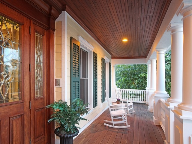 Big front porch, rocking chairs, wood ceiling, white columns, life in the south, Marco Island, Florida