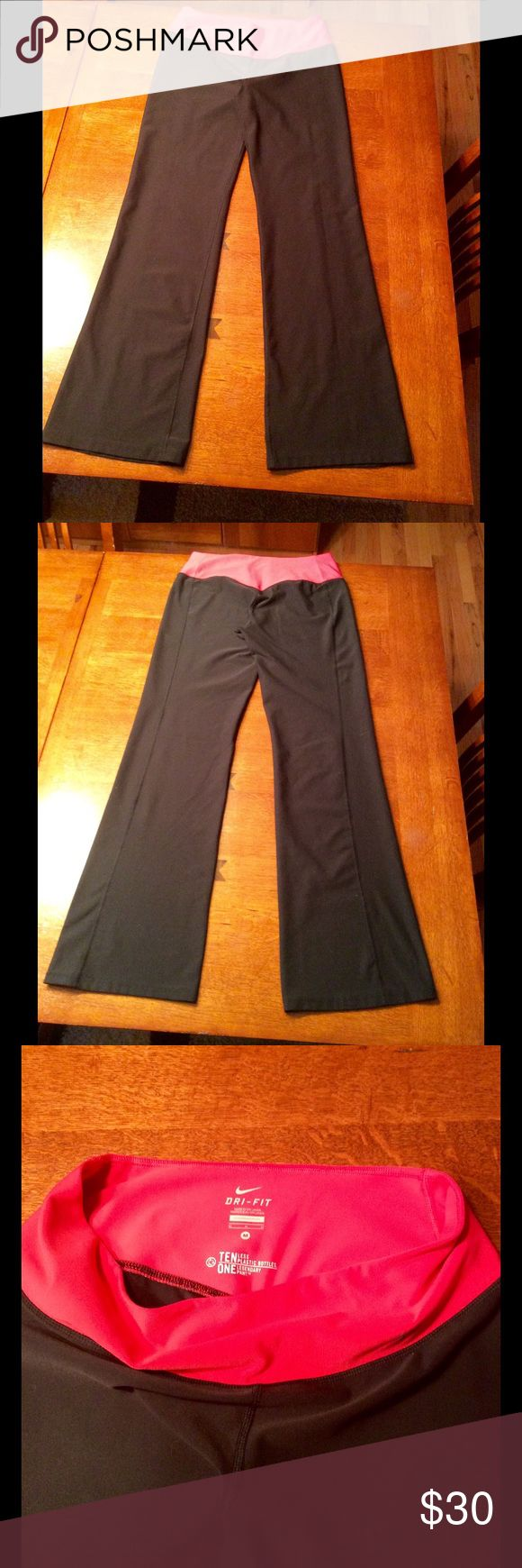 New listing 💕 Nike legend classic training pant Women's legendary classic training pant in size medium.  Slim leg, wide leg opening. Polyester/spandex blend.  Pink waistband and black pant. Hidden slit pocket inside front waistband.  Waitst measures 14 1/2 in flat across, hips 19 1/2 in and inseam is 32 in.  Leg opening flat along bottom is 9 1/2 in.  Pants have been gently worn but are in excellent contrition. Nike Pants