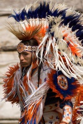 September 17, 2011: A First Nations Canadian wearing traditional clothing participates in a Pow Wow dance during the annual Native Harvest Festival and Pow Wow at the Attawandaron Village located in the Museum of Ontario Archaeology in London, Ontario http://www.mediamarksmen.com/