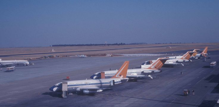 South African Airways Boeing 737s and 727s on tarmac of Jan Smuts Airport, Johannesburg, South Africa.