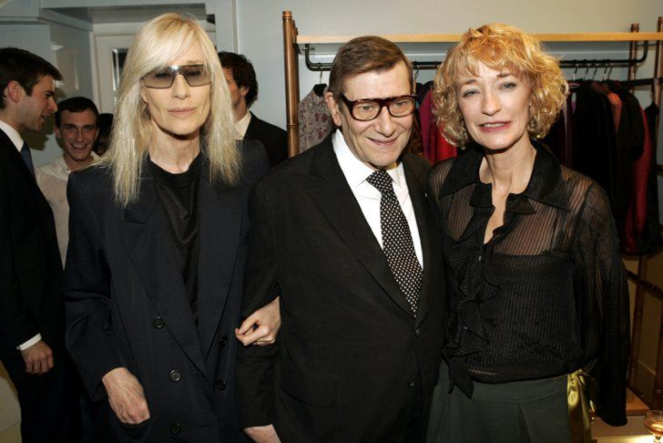 Pin for Later: On His Birthday, a Look Back at the Life of Yves Saint Laurent Yves Saint Laurent Yves Saint Laurent with Loulou de la Falaise and Betty Catroux at the Loulou de la Falaise cocktail party during Paris Fashion Week in July 2004.