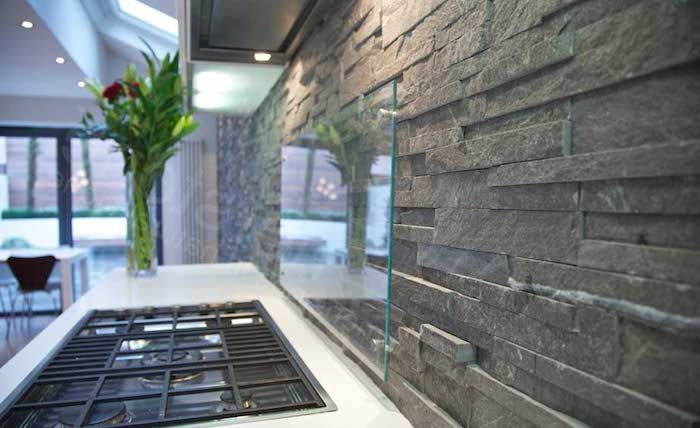 Protector Made Out Of Clear Glass Near A White Counter Top With An