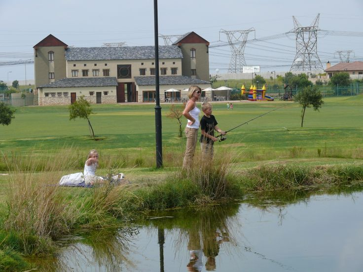 Families enjoy the fly fishing dams next to the  putting range at the Midfield Golf Course. For more information visit www.midrand-estates.co.za