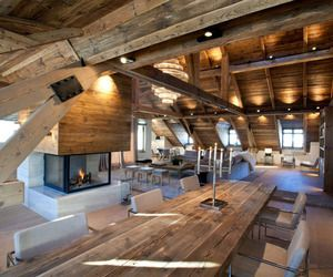 Iced Water is a rustic but modern apartment was created by Bo Design.    The home resembles a cabin located in the middle of the woods, with its thick ceiling beams and walls and ceilings of wood, but is at the same time fitted with modern furniture, creating an eclectic warm haven.