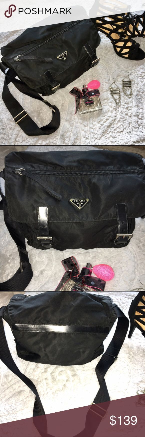 Vintage Authentic Prada Bag!  Prada Vela cross-body messenger. It has some signs of wear. The lining in the flap pocket is ripped but the inside of the bag is in good condition. Authentic Prada! Awesome bag! Prada Bags Crossbody Bags