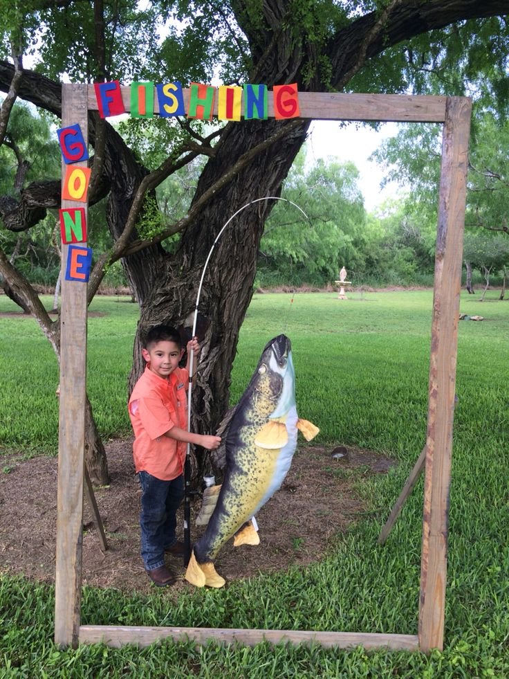 Made a gone fishing wood frame for pictures. Used a big fish pillow and hooked it to a rod for the big catch :) Noah's fishing theme party