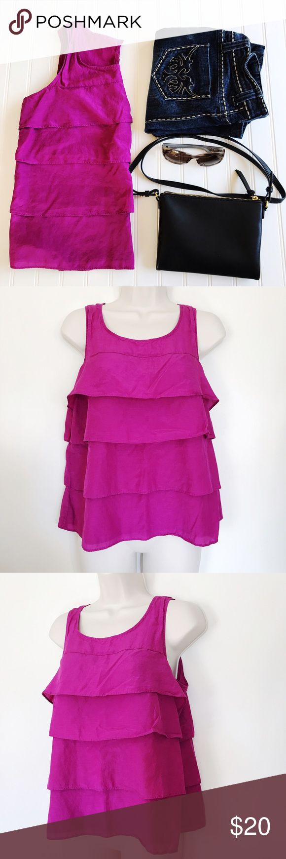"Ann Taylor purple ruffle sleeveless blouse Ann Taylor purple ruffle blouse.  This is a very versatile piece.  Can be paired with a pencil skirt or nice trousers and some heels for the office or some skinny jeans for a night out!  No rips or stains.  There is a small pull in the fabric on the back under the right shoulder blade which you can really only see when holding it up to the light.   Material  52% Silk 48% Cotton   Measurements Bust: 18""  Waist: N/A Length: 21""  Offers welcome! No…"