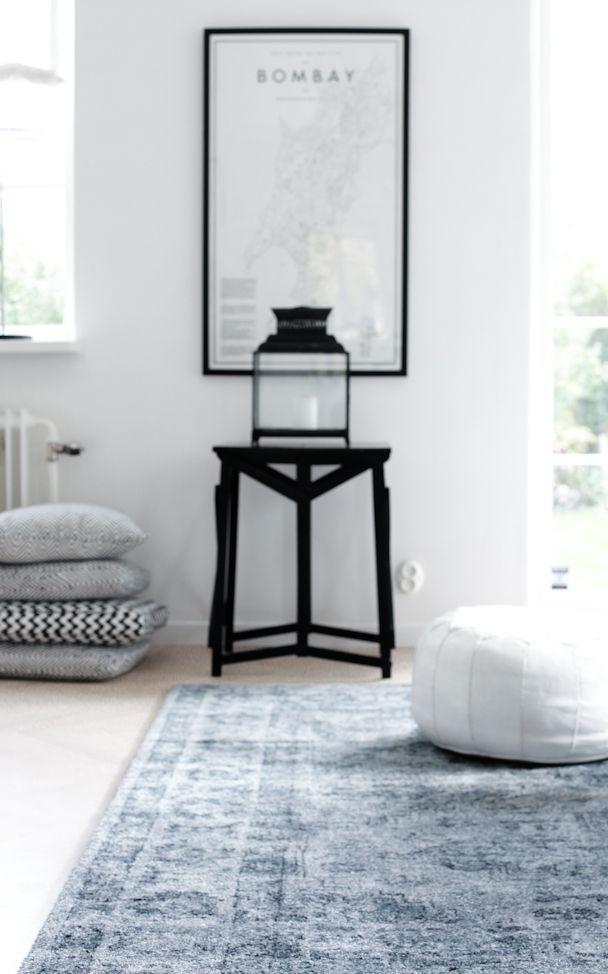 Black white and grey room, grey rug.