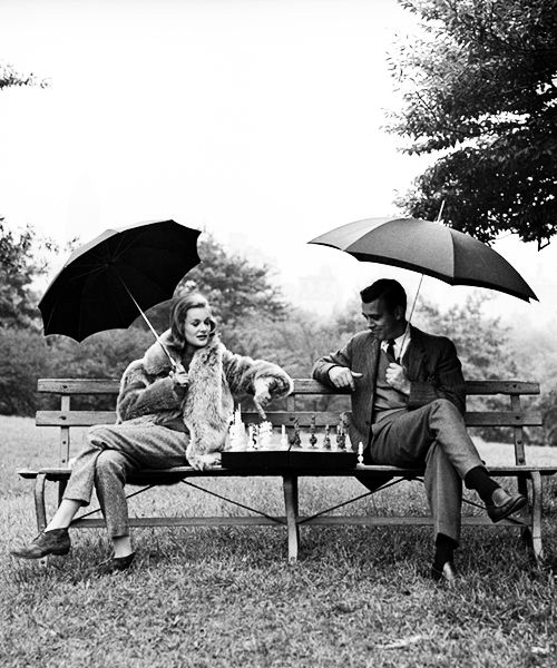 Monique Le Fevre and a Man playing chess in Central Park photographed by Jerry Schatzberg, New York, 1958.