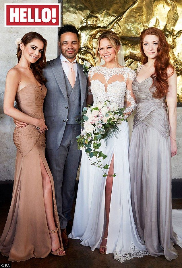 Bridal beauty: Kimberley Walsh has given fans the first glimpse of the white lace cut-out wedding gown she wore while tying the knot to new husband Justin Scott last month. She's pictured above with bridesmaids Cheryl Fernandez-Versini and Nicola Roberts