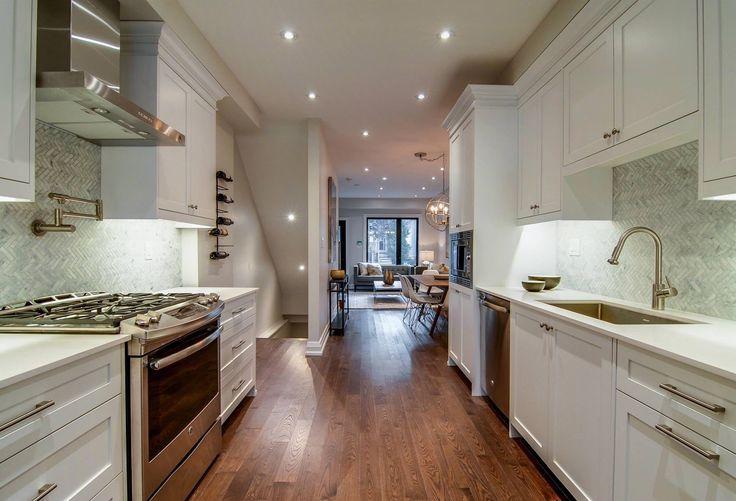Custom white kitchen by Watchtower Interiors Inc.