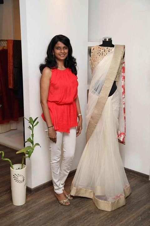 Off white saree with gold border and sleeveless high neck blouse. Simple and elegant.