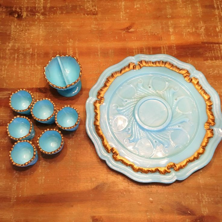 Beautiful set of French opaline glass egg cups or liquor glasses on a tray. The center piece is probably a salt, but can also be used for other things