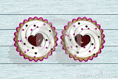 Two 3d cupcakes lying on wooden desk