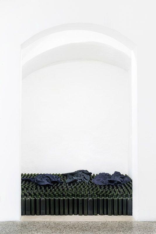 Jannis Kounellis, Senza Titolo, 2015, bottles, jackets. Galleria Continua San Gimignano 2015. Photo by Ela Bialkowska.