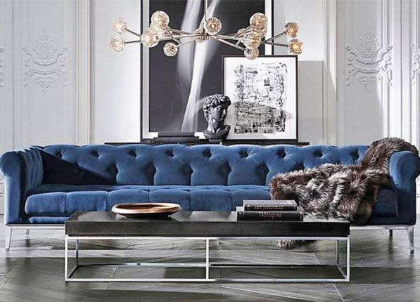 The New Rules of Modern Decor-Still thinking of modern seating as hard and uncomfortable? RH Modern explodes that cliché by redesigning the traditional chesterfield sofa to be sleek (metal legs and a squared-off frame) but still sumptuous.