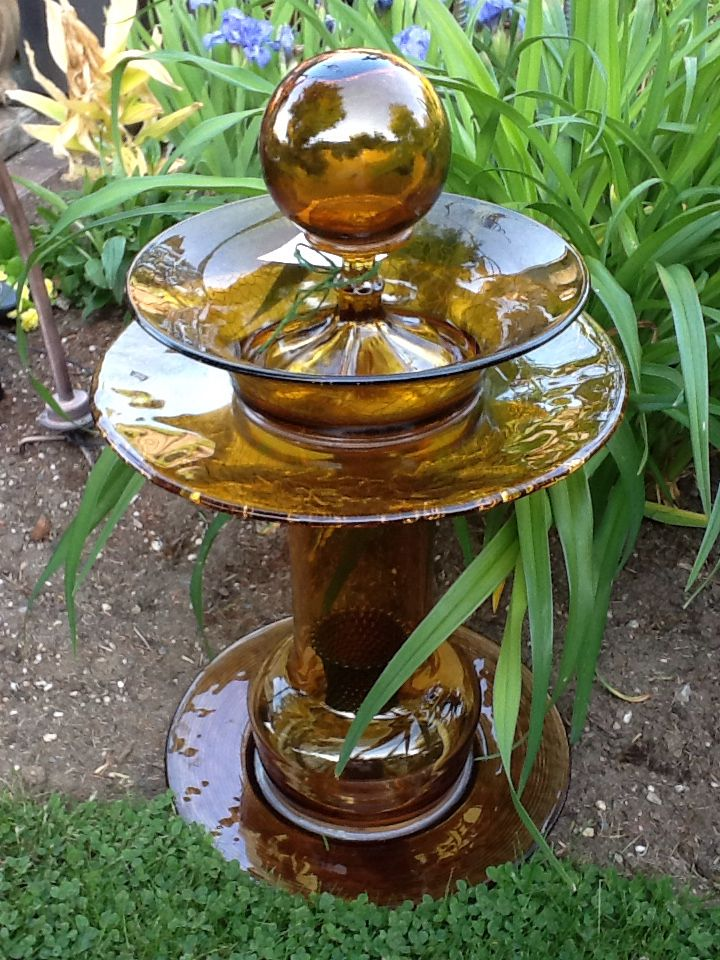 Amber glass bird bath makes a beautiful addition to the garden.