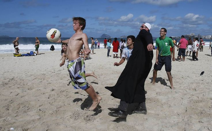 Clarin.com HD: Foto -- An Argentine priest plays football on the beach with Argentine and Brazilian guys, while waiting for the arrival of Pope Francisco to Copacabana for a new meeting with the Catholic faithful gathered here. (Reuteres) - See more at: http://hd.clarin.com/page/22#sthash.2AJsTvoq.dpuf