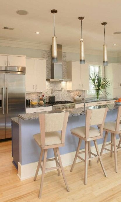 Contemporary small kitchen with plenty of light with a double stainless steel wall oven.