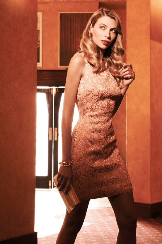 Xile Dolce & Gabbana brocade dress, $1,495; Colette by Colette Hayman Rosey multi row chain nail necklace, $16.95; big stone ring, $9.95; Sportsgirl chunky gold bracelet, $16.95; Lovisa bracelet, $16.99; Mimco Intergalactic clutch, $179