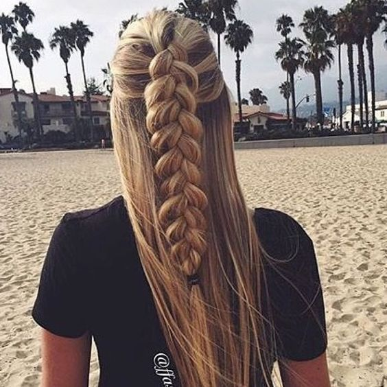 This schoolgirl favorite is all grown up. See the 12 new braided hairstyle ideas women can't get enough of and learn exactly how to do them. dress makeup world brown hair wedding