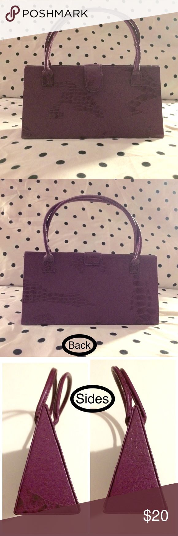 """Purple """"mock croc"""" triangular hand-held mini purse Color: purple. Shape: rectangle (front view); triangle (side view). Crinkle-textured synthetic leather with a hard foundation & intermittent 🐊-skin pattern. ⚠️NO brand indicated anywhere⚠️ Excellent used condition - a couple of *water* stains on the *inside* & some small *nicks* on the *outside*. (See *last* pic for flaws.) 👍 OFFERS WELCOME 👍 Measurements: length - 7 3/8""""; height - 3 5/8"""" (yes, it's TINY, haha 😉); depth - 2""""; handle drop…"""