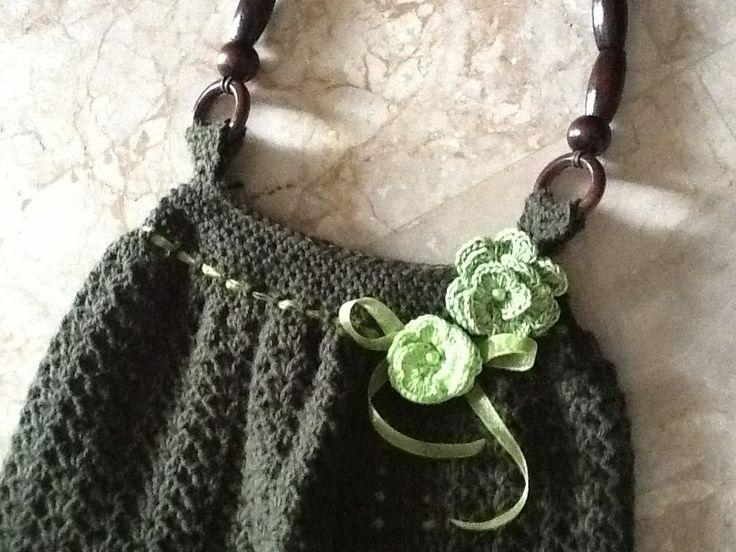 details from dark-green bag