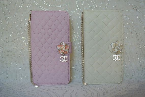 LEATHER QUILTED FLOWER DIAMOND CASE for iPhone 6 PLUS with Swarovski Crystals ~ Bling!    Iphone Case Description    Quilted Flower Iphone 6 Case PLUS made with 100% Swarovski Crystals  Wristlet Chain Handles has a removable Swarovski Crystal Heart Charm that can also be used on a Bracelet or Necklace  Flower emblem on magnetic closure with dangle diamond charm  There are 2 inside slots for Business, Credit, or ID Cards, etc. ~ and 1 Open Pocket for Cash, etc.  Case has easy tilt for…