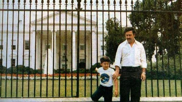 Notorious drug lord Pablo Escobar and his son in front of the White House, 1980s.